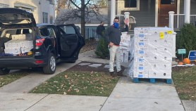 Turkey delivery coincided with a distribution day. An Oak Park family received the pallet of turkeys on their front lawn. Ricardo Garcia, pantry manager, and volunteers shuttled the birds back to Beyond Hunger's freezer.