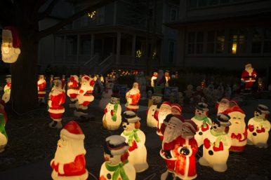 Dozens of antique plastic lit up santas and snowmen are seen in the front yard of a home on Elmwood on Thursday, Dec. 17, 2020, in Oak Park, Ill. | ALEX ROGALS/Staff Photographer