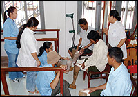 Students at the Cambodian School of Prosthetics and Orthotics (CSPO) in their final year at work in the CSPO clinic. Photo by Carson Harte.