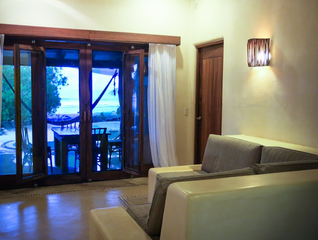 Casa Oasis Troncones Downstairs two bedroom beach house indoor living area with ocean view sofa
