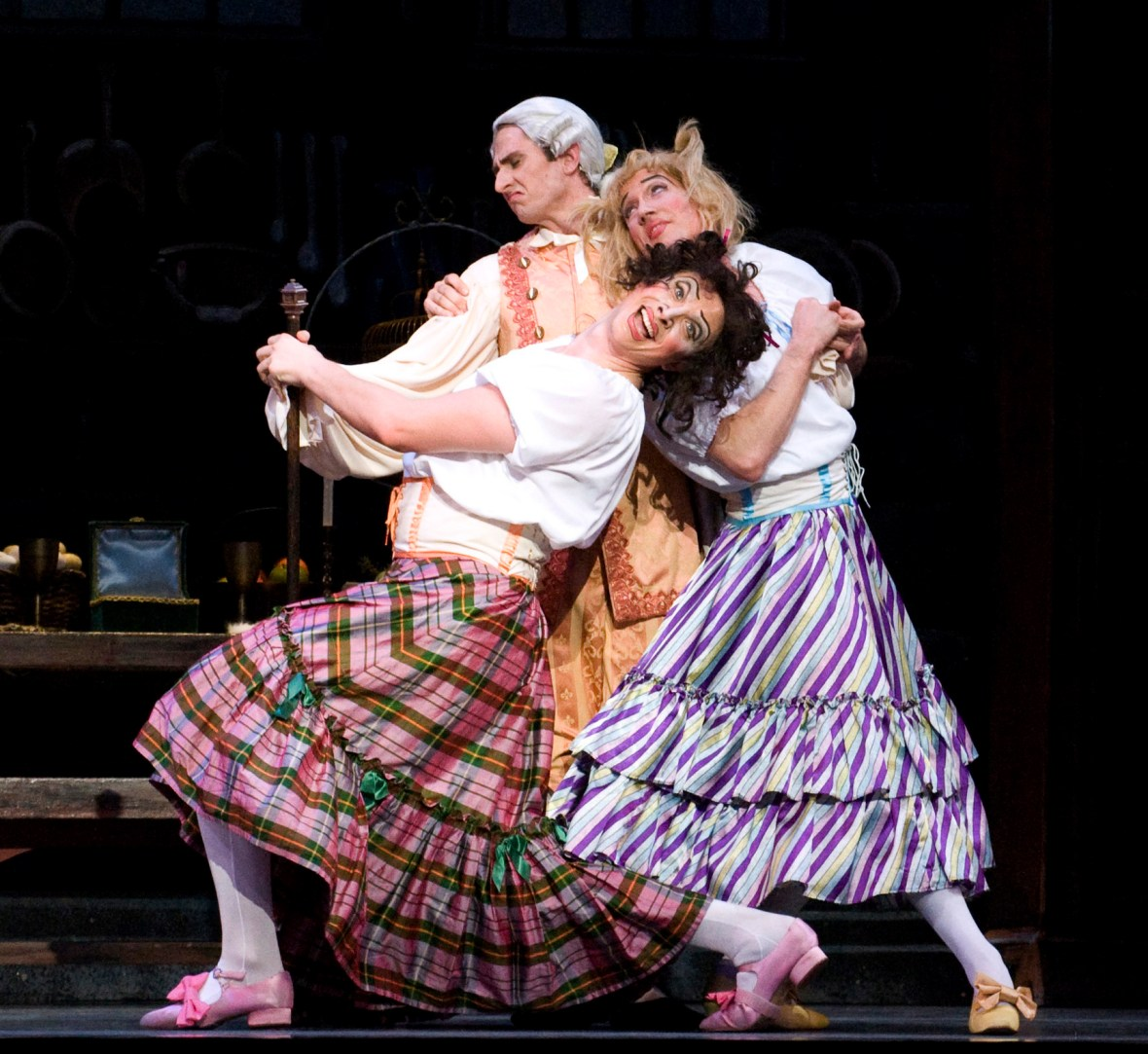 "Clockwise: Thomas Baker (as the Dancing Master), Michael Linsmeier and Brett Bauer (as the ""Ugly Stepsisters"") in the company premiere of Ben Stevenson's ""Cinderella,"" running February 28 - March 7, 2015, at Portland's Keller Auditorium. Photo by Randall Milstein."
