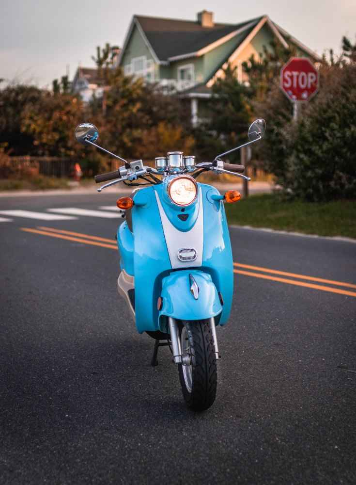 Standalone front shot of blue scooter