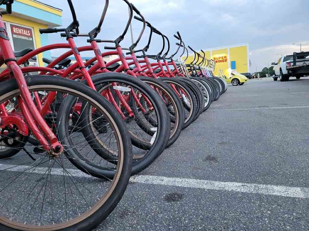 Closeup picture of rental bicycles lined up outside of the shop
