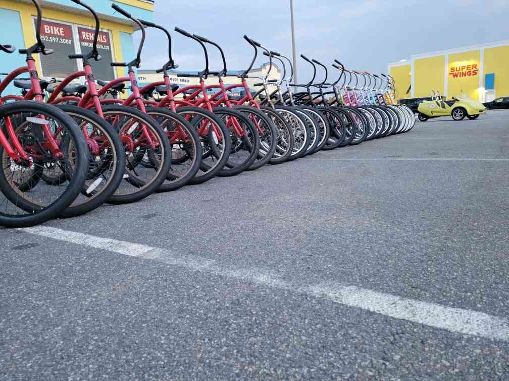 Far away picture of rental bikes lined up outside of the shop