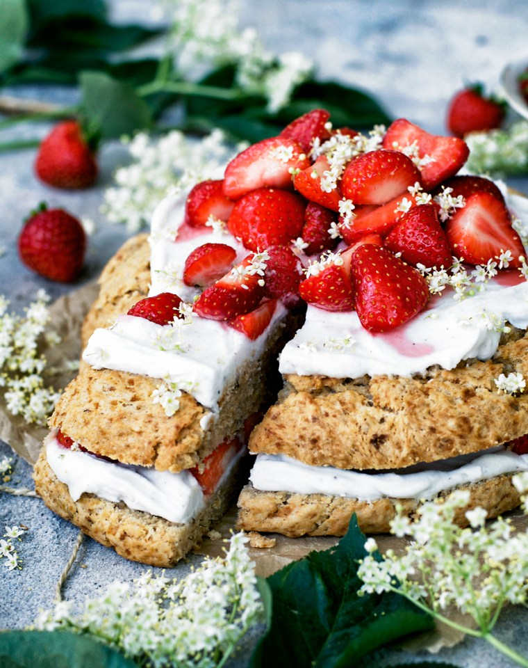 Giant scone layer cake with strawberries and elderflowers.