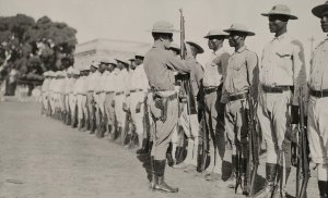 In 1920, a US marine whips a troop of Haitian soldiers into shape