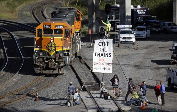 fossil fuel resistance, fossil fuel economy, Shell, Dakota Access Pipeline, DAPL protests, Standing Rock Sioux tribe, Washington Environmental Council, oil trains, oil train transport, oil by rail, environmental resistance, Trans-Pacific Partnership, TPP,
