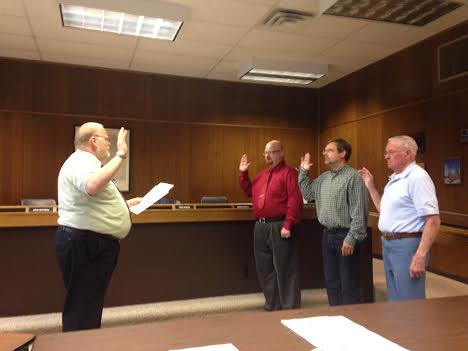 Oceana County Family Court Judge Brad Lambrix, at left, swears in Harold Schaner, at right, as Hart's newly-elected mayor, and newly-elected councilman Jason LaFever, second from left, and re-elected councilman Fred Rybarz Tuesday night before the council meeting in city hall. Schaner, who was elected last week, replaces former mayor Ron LaPorte, who could not run for re-election due to term limits. One open seat remains on the seven-member council, and that seat will be filled by appointment.