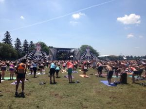 Forest Festival attendees participate in yoga at the Tripolee stage.