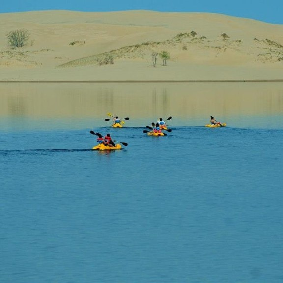 Gina Ferwerda's award-winning photo of kayakers at the Silver Lake Sand Dunes.
