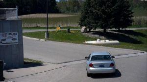 The suspect vehicle leaving Wilson's Market.
