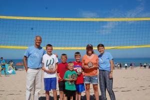 Patrick Fuller, at left, and his daughter Anna, at right, during the Cancer and Critical Care Fund Beach Volleyball Tournament during Pentwater Homecoming.