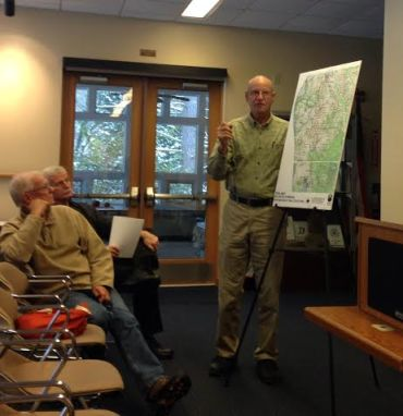 Joel Mikkelsen, who was key to making the William Field Memorial Hart-Montague Rail Trail a reality with its namesake Bill Field, addresses the audience during a meeting that focused on rebuilding the 25-year-old trail.