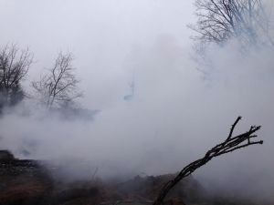 Heavy smoke continues to pour from  the site of a fire that destroyed a two-story century-old farmhouse in Crystal Township early Tuesday morning.