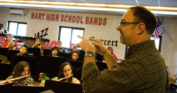 Band director John Taranko leads the middle school band in the current band room.
