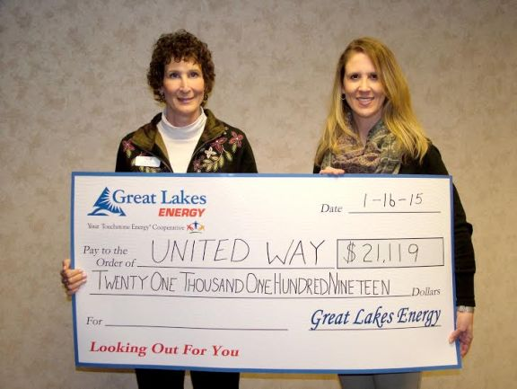 Great Lakes Energy employees, in partnership with cooperative lender CoBank, donated $21,119 to local United Way agencies and charities including Crystal Valley Care Fund and Love INC of Oceana. Char-Em Executive Director Lorraine Manary, left, accepts the check for United Way from Shari Culver of Great Lakes Energy.