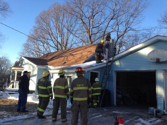 Grant Township and Shelby-Benona firefighters extinguish a chimney fire in Claybanks Township Tuesday morning, Jan. 27.