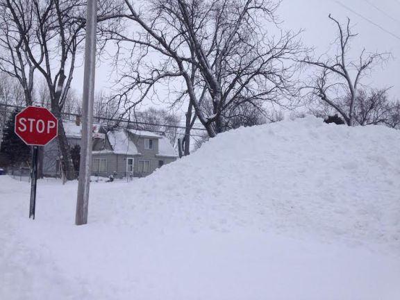 This snow bank in the parking lot at Gale's IGA in Hart has surpassed the height of the stop sign.