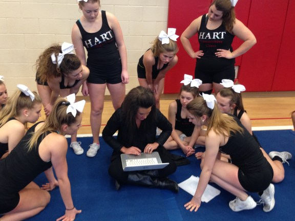 Jen Hlady goes over a plan with her team.