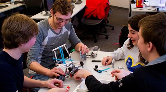 Left, Clayton Malkowski (MCC), Tyler Corliss (Hart), Kaci Clayton (MCC) and Travis Carr (Walkerville) work on Lego robotics during their ASM Tech core class.