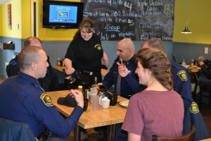 Waitress Laura Hammond pours coffee at the Golden Eatery in Mears for the Michigan State Police officers. Also seated at the table is Mears resident Jacquelyn Veldkamp, whose husband Lance is a new trooper at the Hart post.