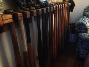 A rack of bats in Don's house right next to his TV where he relaxes to watch his beloved Detroit Tigers.