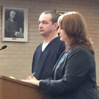 Raymond Kirby, with his attorney, Julie Springstead Waltz, during a July hearing.