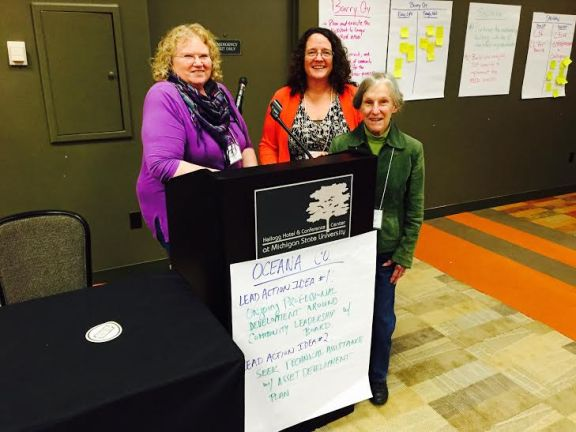 Trustees Nancy Sterk, Jean Russell and Executive Director Tammy Carey (center) at the Michigan Community Leadership Network Institute in East Lansing.