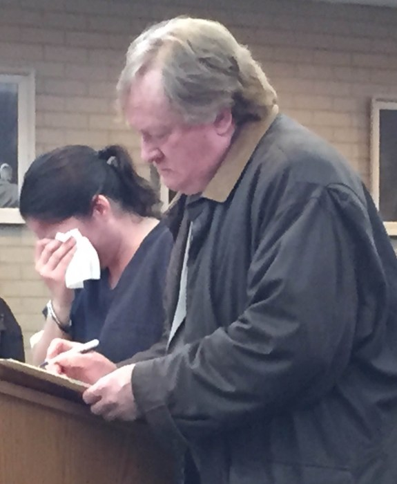 Abigail Dutton weeps during a pretrial hearing in 27th Circuit Court as she stands next to her attorney John Greer.