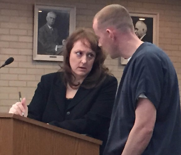 Aaron Jacobs with his attorney, Julie Springstead Waltz.