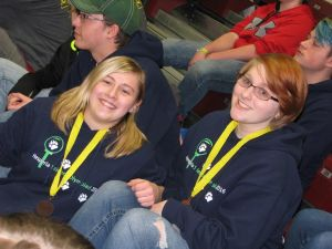 Juniors Camryn Johnson (left) and Olivia Erlewein won first place in the event, Invasive Species.