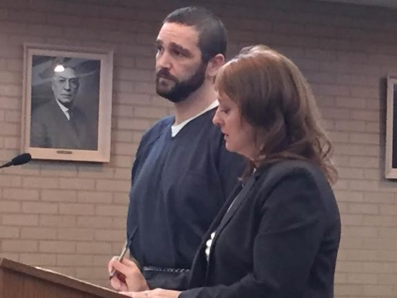 Jason Barnes with his attorney, Julie Springstead Waltz.