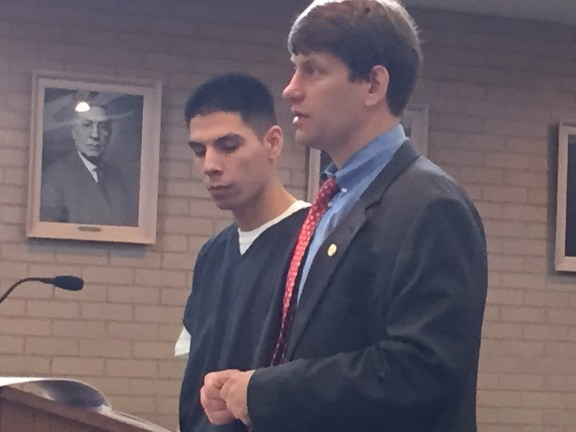 Brett Peoples with his attorney, David LaGrand.
