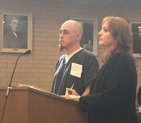 Timothy Veltman with his attorney, Julie Springstead Waltz.