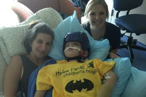 Connor with his mom, at left, and nurse.