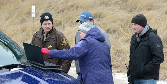 Liz Reimink of Mason County Emergency Management discusses the search with OC Sheriff Craig Mast, left.