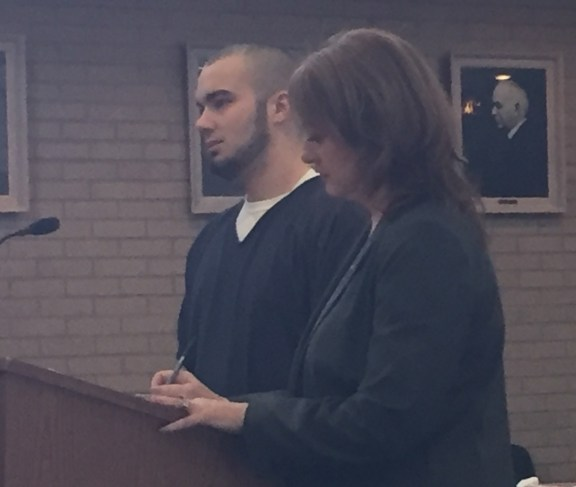 Joshua Flanery with his attorney, Julie Springstead Waltz.