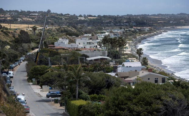"""The Beach House Malibu, billed as the """"world's most elegant and beautiful sober living environment located in exclusive and private Malibu,"""" according to its web pitch, hosts public AA meetings, neighbors said. People arrive by the vanful, and dozens of vehicles line the narrow road along the ocean. Pictured is Broad Street where it is located.(Photo by Mindy Schauer, Orange County Register/SCNG)"""