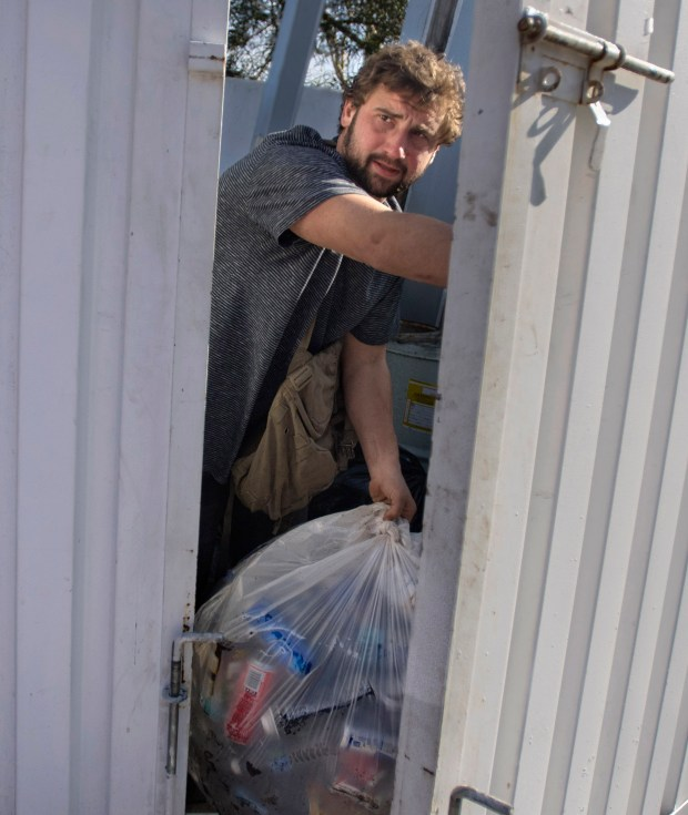 "Timmy hunts for cans in the garbage and turns them in for cash at the recycling station to buy drugs. On his best day he earned $220. ""I never pictured this as my life, ever dude. I never thought I'd be 28-years old and sticking my hand in a f---ing trash barrel. It f---ing kills me. It makes me want to f---ing die. I'm that f---ing miserable,"" he says. (Photo by Mindy Schauer, Orange County Register/SCNG)"