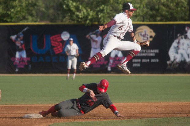 Mater Dei's Blake Hunt slides underneath JSerra's Royce Lewis to steal second base during a Trinity League baseball game in San Juan Capistrano on Friday, April 28, 2017. (Photo by Drew A. Kelley, Contributing Photographer)