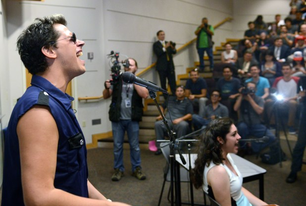 Milo Yiannopoulos started off his appearance with a boisterous singing of the Star Spangled Banner at UC Irvine in 2016. (Photo by BILL ALKOFER, Orange County Register/SCNG)