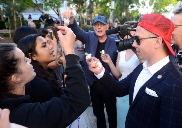 UCI Republican Club vice president Peter Van Voorhis handed out pacifiers to protestors at a Milo Yiannopoulos lecture sponsored by his club in 2016. (Photo by BILL ALKOFER, Orange County Register/SCNG)