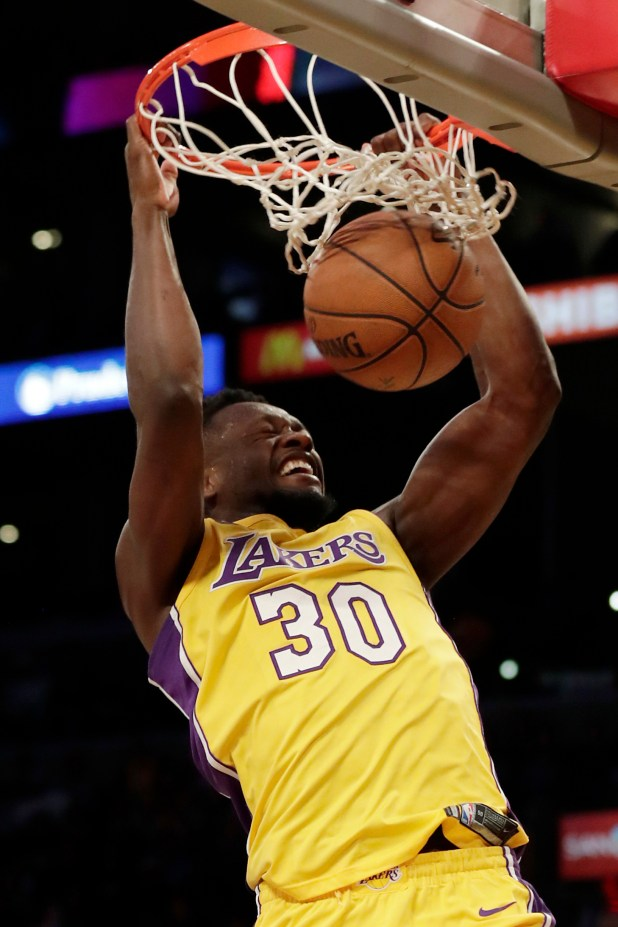 Los Angeles Lakers forward Julius Randle dunks during the first half of an NBA basketball game against the Brooklyn Nets, Friday, Nov. 3, 2017, in Los Angeles. (AP Photo/Ryan Kang)