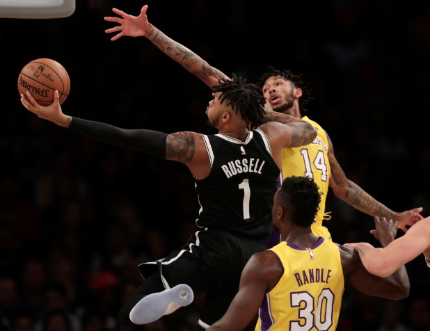 Brooklyn Nets guard D'Angelo Russell, left, goes to the basket while defended by Los Angeles Lakers forward Brandon Ingram, right rear, during the first half of an NBA basketball game, Friday, Nov. 3, 2017, in Los Angeles. (AP Photo/Ryan Kang)