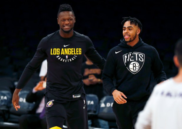 Los Angeles Lakers forward Julius Randle, left, and Brooklyn Nets guard D'Angelo Russell, right, stand on the court before an NBA basketball game, Friday, Nov. 3, 2017, in Los Angeles. (AP Photo/Ryan Kang)