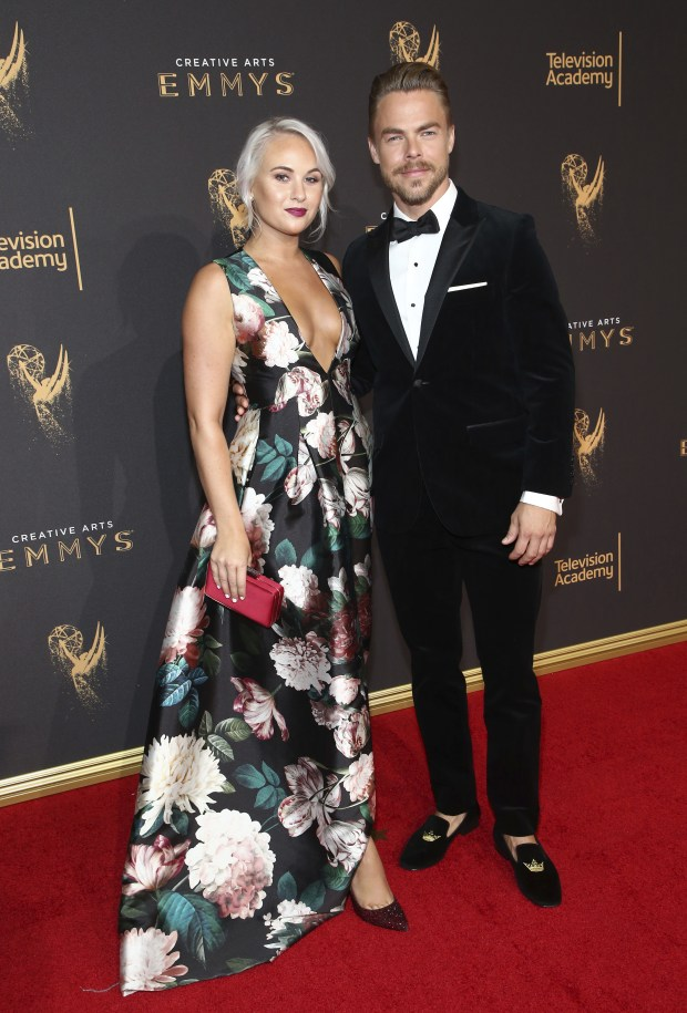 Kelsey McCowan, left, and Derek Hough arrive at night one of the Television Academy's 2017 Creative Arts Emmy Awards at the Microsoft Theater on Saturday, Sept. 9, 2017, in Los Angeles. (Photo by John Salangsang/Invision for the Television Academy/AP Images)