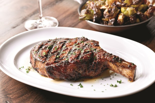 Bone-in ribeye is just one of the steak offerings on Mastro's menu, which also lists a 24-ounce porterhouse and a 16-ounce New York strip. (Courtesy of Mastro's Steakhouse)