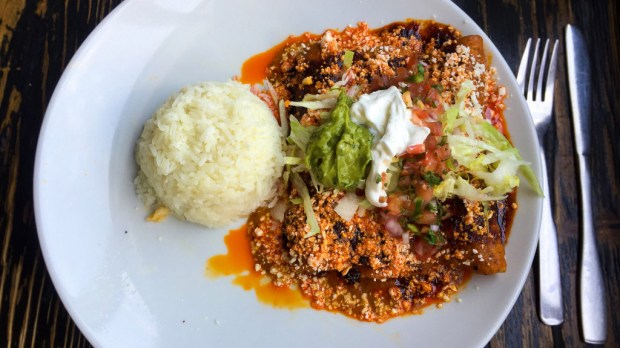 Pork pibil enchiladas are on the menu at Anepalco on Chapman in Orange. The restaurant was recently revamped with new decor and refreshed menu. (Photo by Brad A. Johnson, Orange County Register/SCNG)