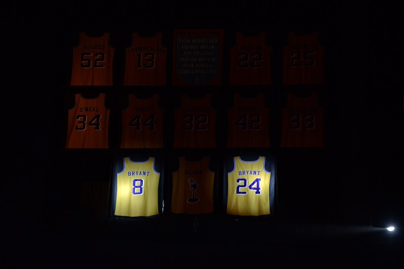 new concept e55d6 925ad Kobe Bryant s  8 and  24 jerseys are unveiled during a ceremony to retire  both the numbers he wore as a Los Angeles Laker at the Staples Center in  Los ...