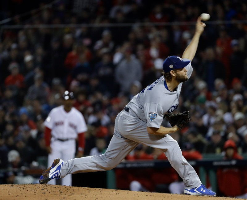 4ee7ff615 Los Angeles Dodgers  Clayton Kershaw throws during the first inning of Game  1 of the World Series baseball game against the Boston Red Sox Tuesday
